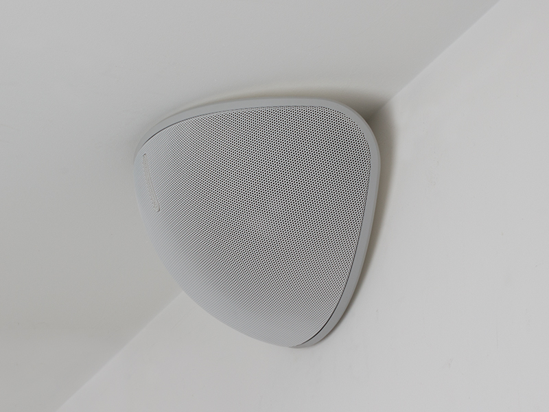 Vecta V240 on-wall speakers, in action on a V-CORNER bracket.