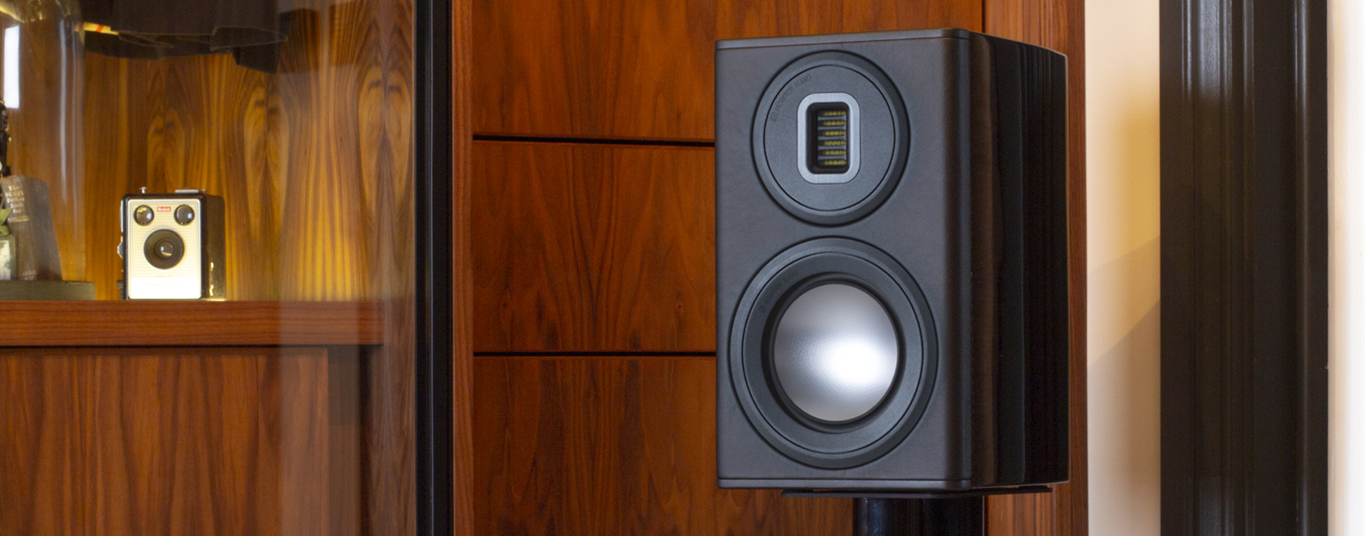 Platinum PL100 II bookshelf speakers, with grilles in three finishes.