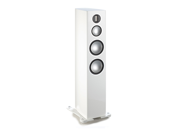 Gold 300, grille-less floorstanding speakers, with a high gloss white lacquer finish.